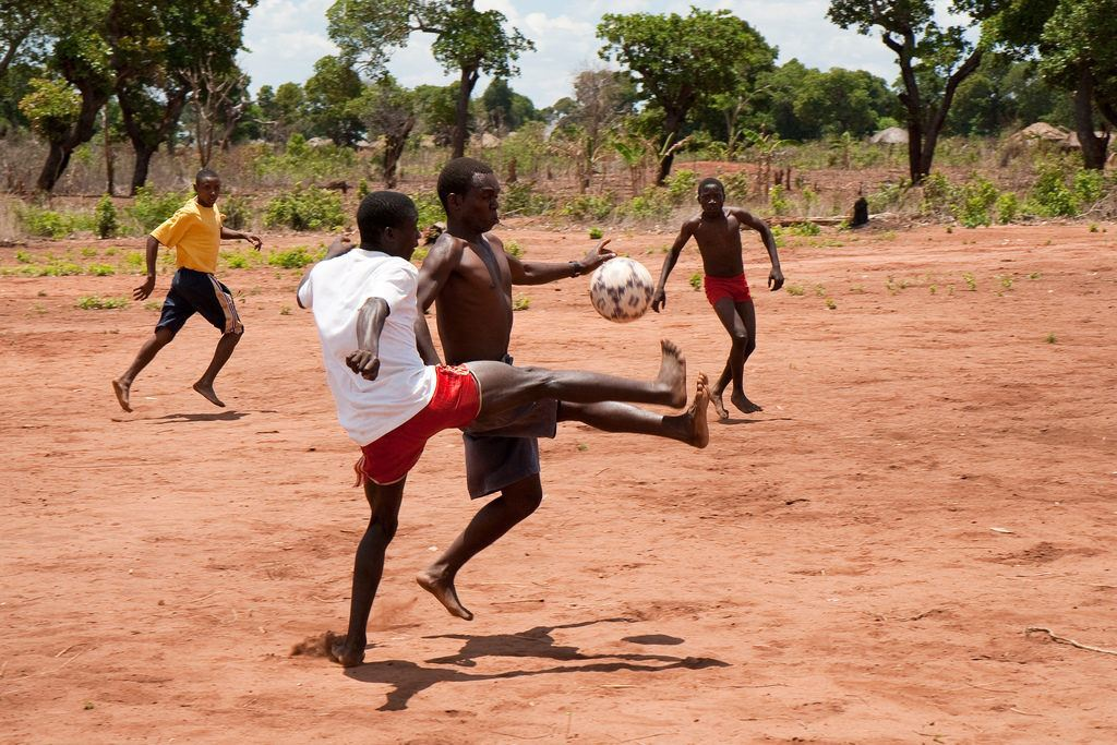 kids playing football in mozambique