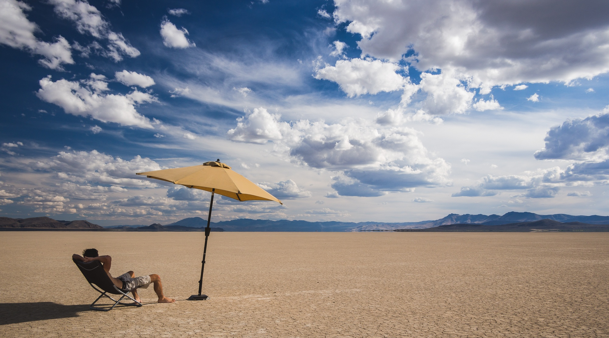 lounging in the alvord desert with an umbrella eastern oregon road trip