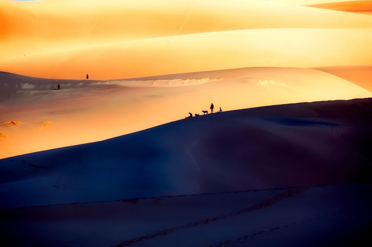 people relaxing on the great sand dunes colorado