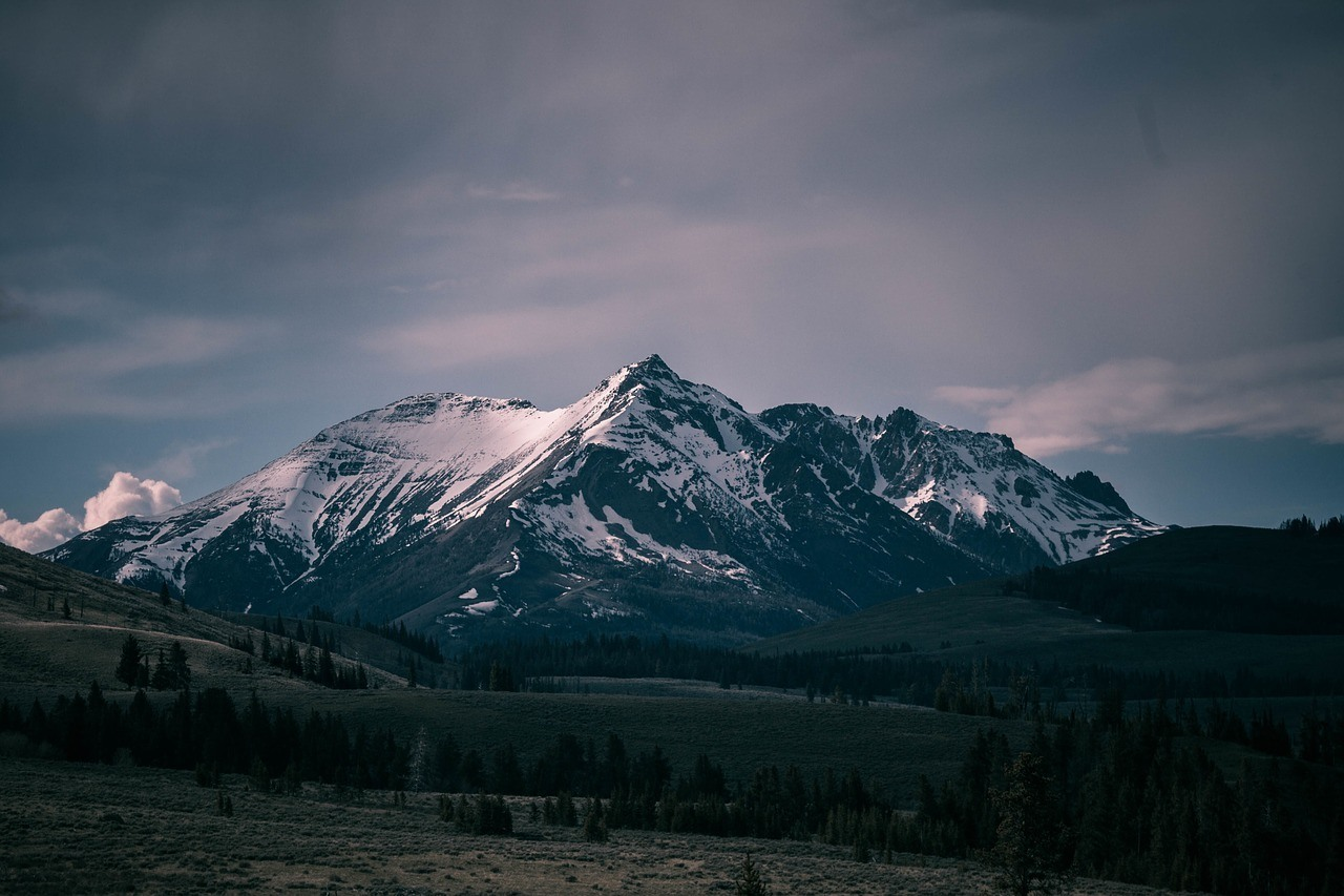 moody rocky mountain photo with dark clouds