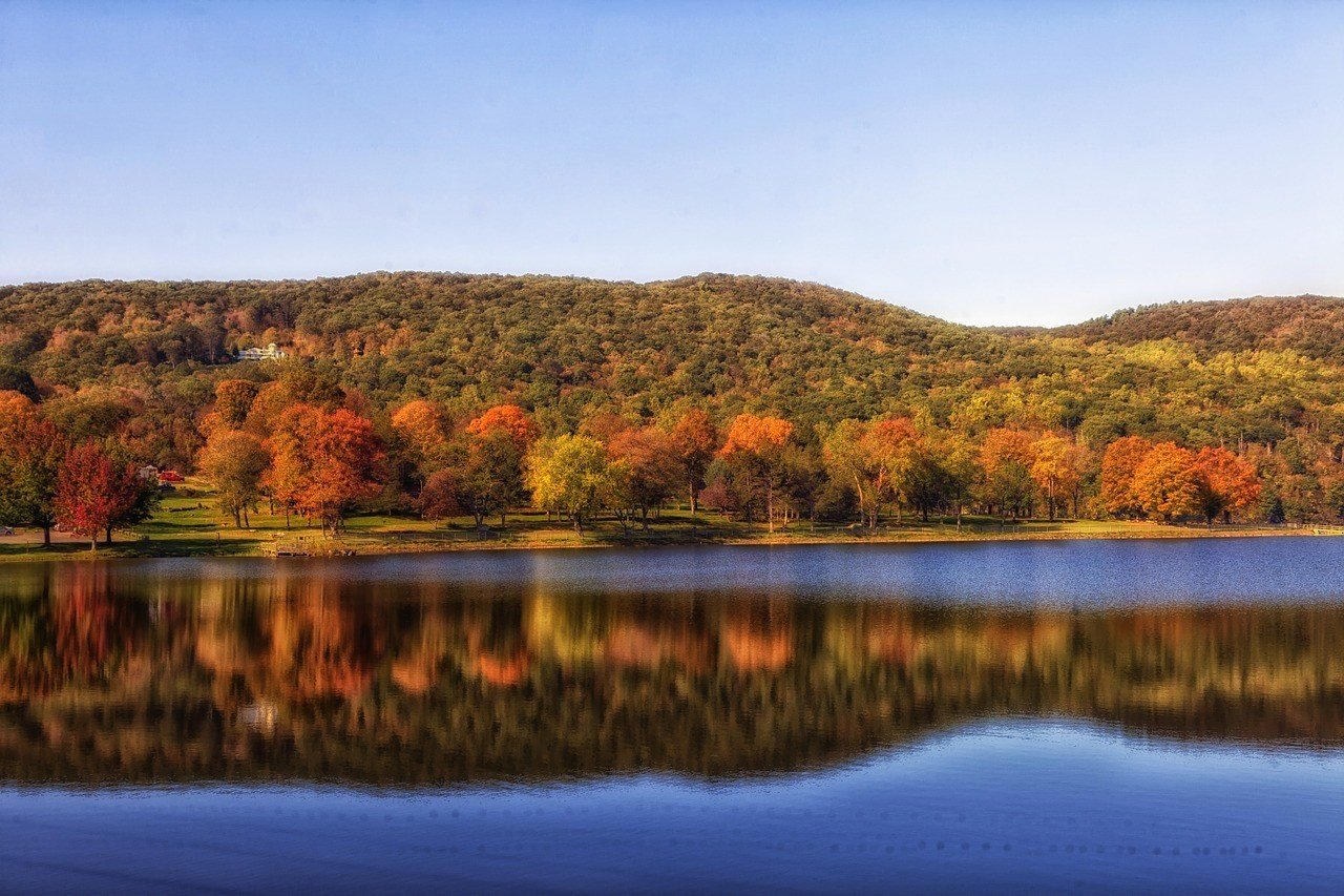 fall foliage in west connecticut pond reflection