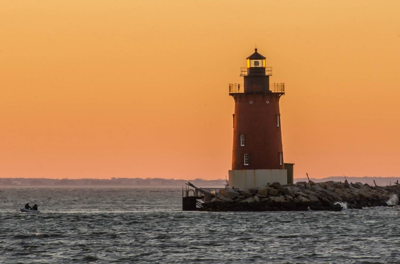 lighthouse on delaware coast sunset