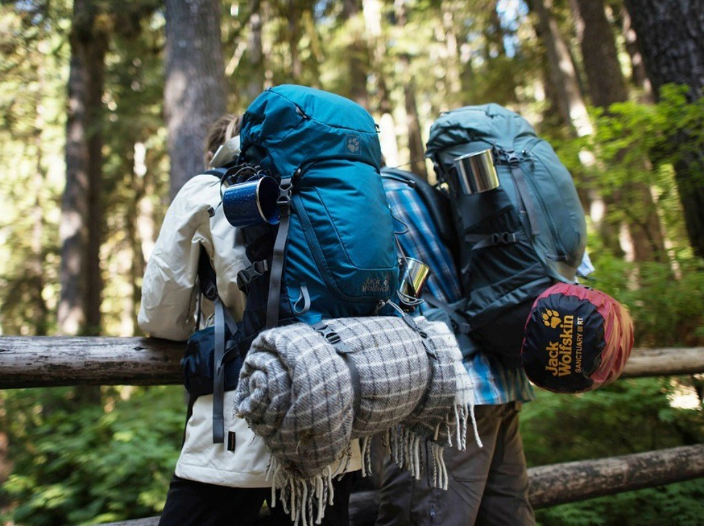 Two travellers with their used backpacking gear setup