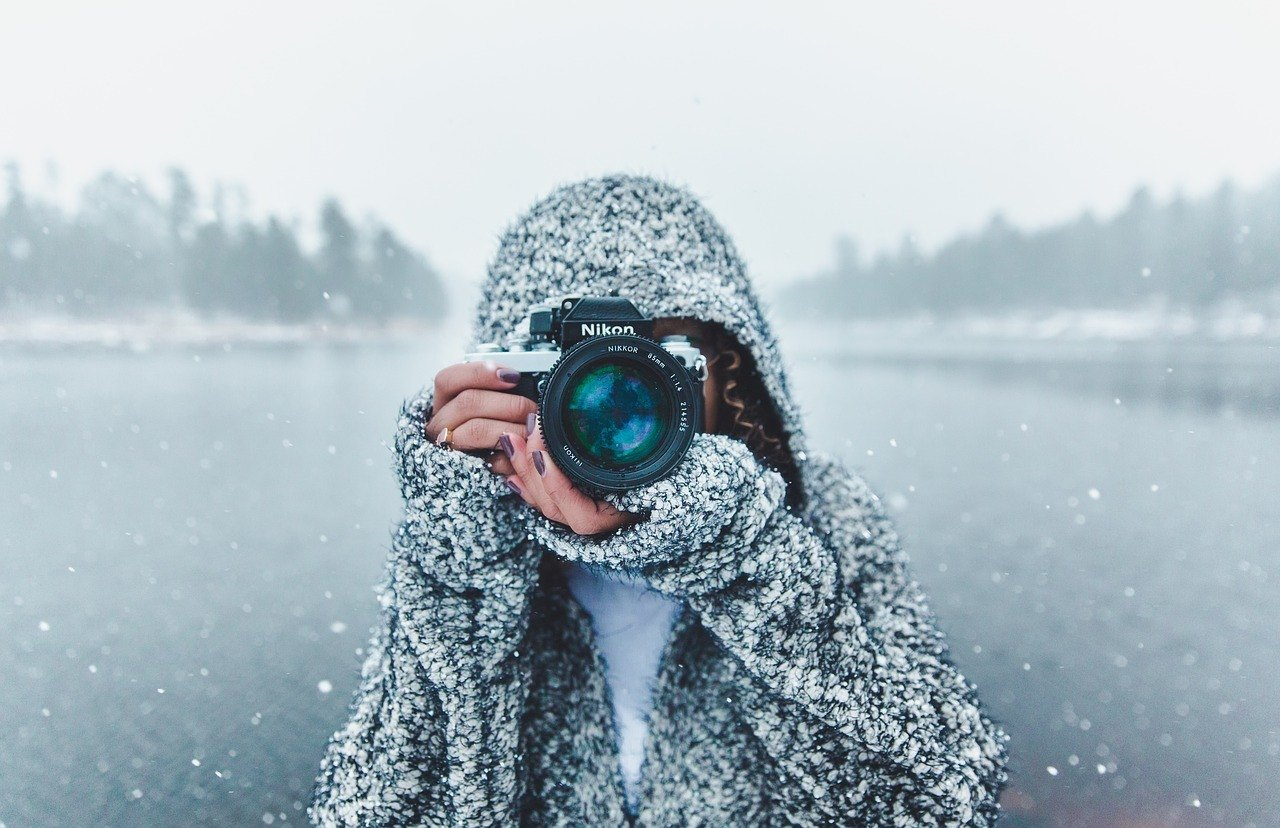 photographer in snow with nikon