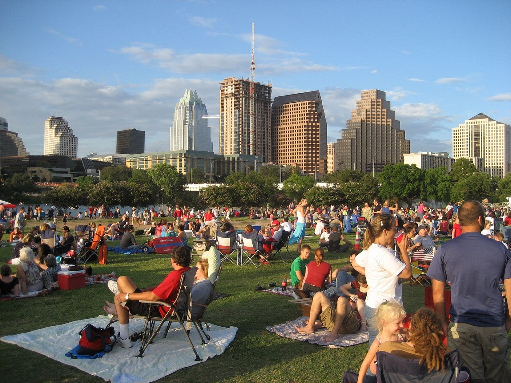 people relaxing in park austin travel guide
