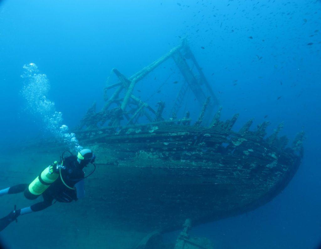 Scuba diver approaches a wreck.