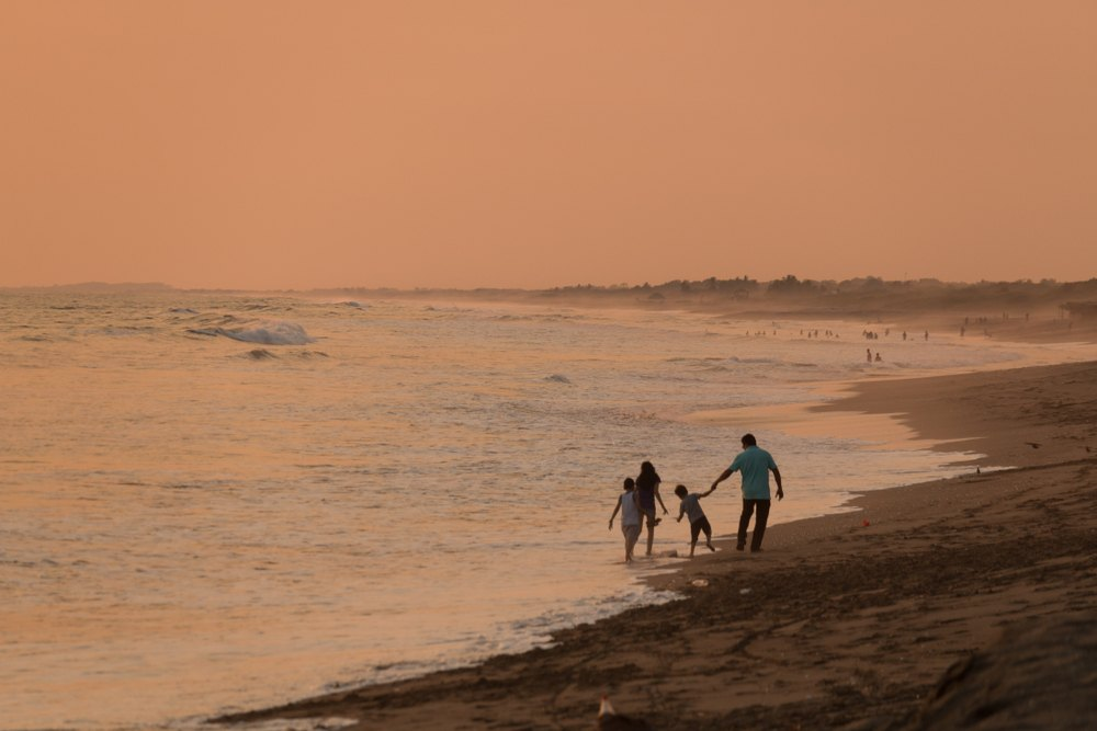 A family on a beach not fearing for their safety in Nicaragua