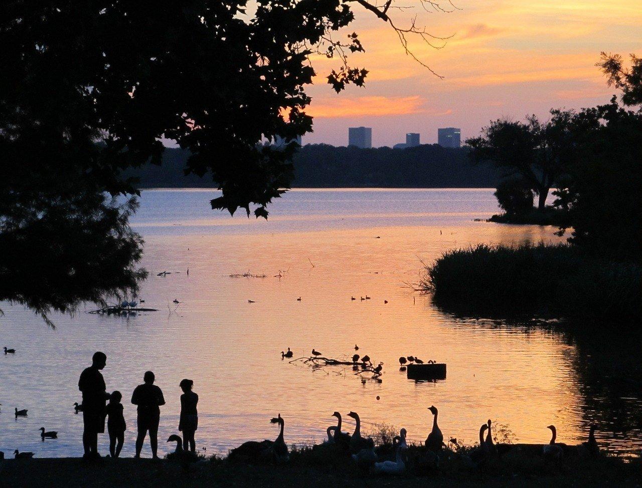 sunset on a lake near dallas travel guide
