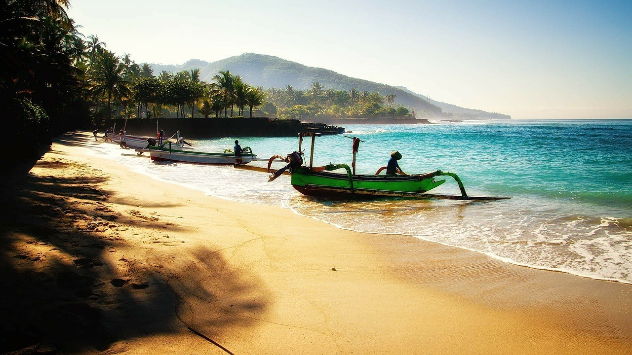 bali safe to visit boats on the beach