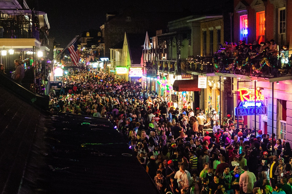 crowds on bourbon street new orleans travel guide