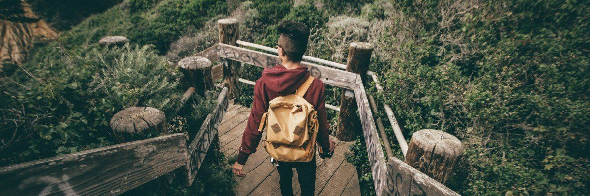 man walking in jungle how to travel safely