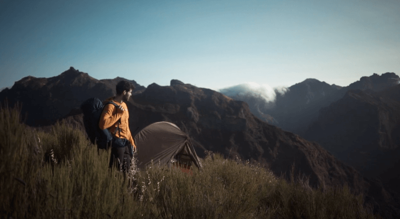 A man hiking with a cheap ultralight tent