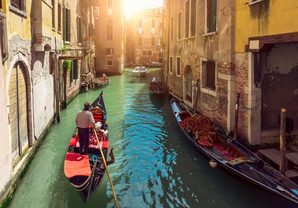 Ride a Gondola Through a Canal Venice
