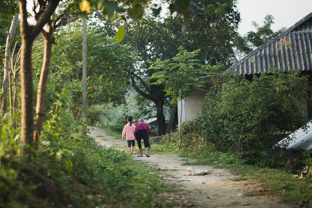 young and old in vietnamese village