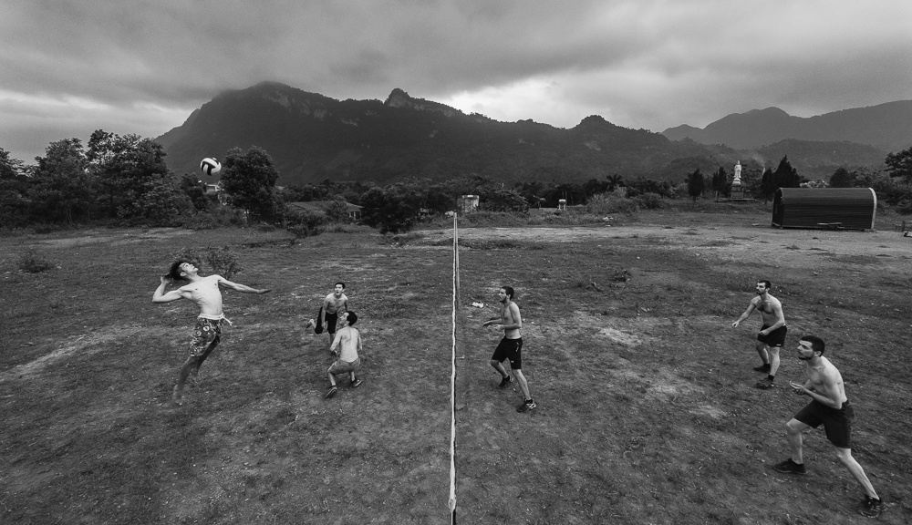 playing volleyball while volunteering with local Vietnamese people