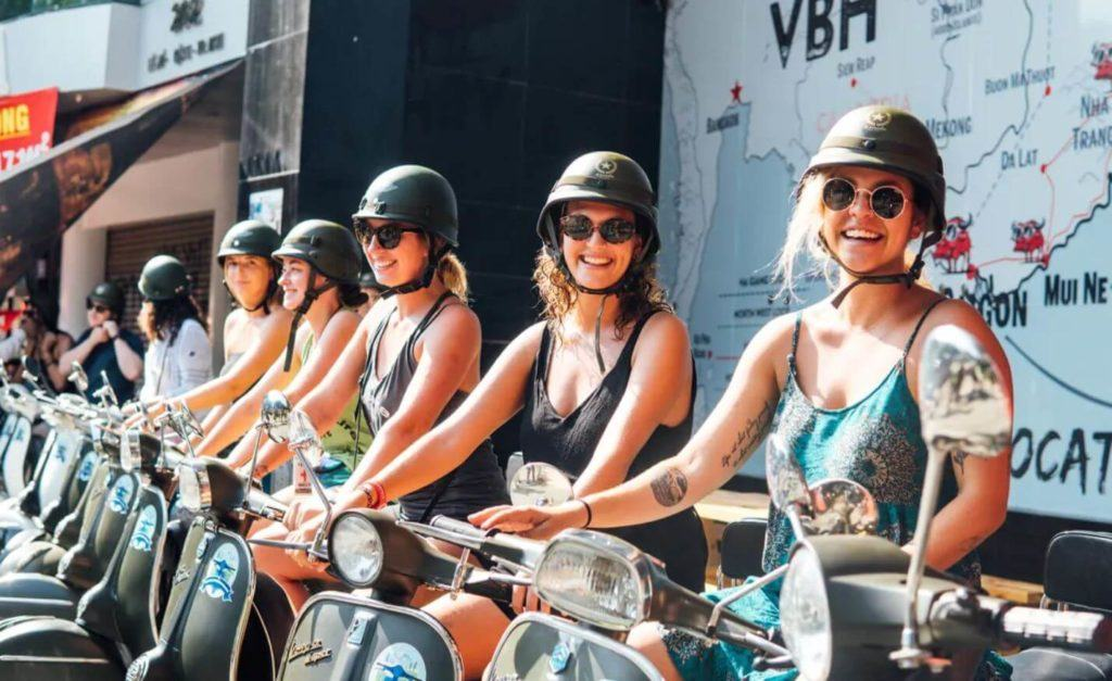 a group renting motorbikes from backpacker hostels