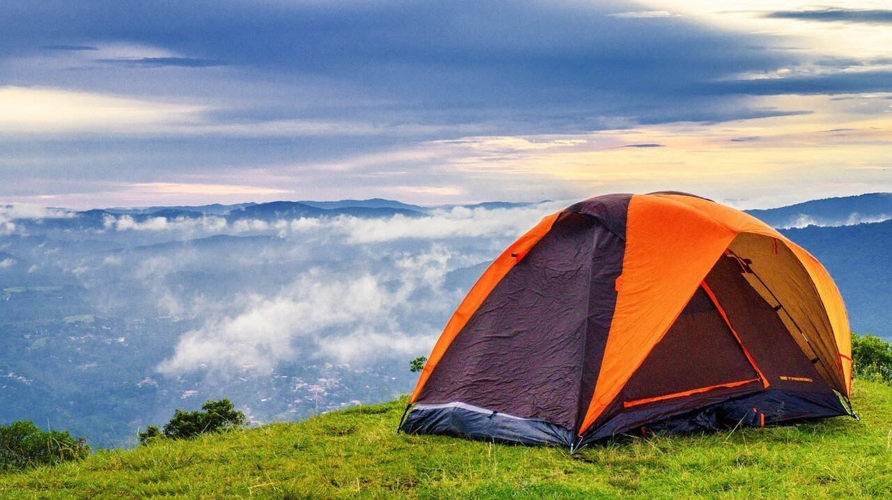 Camping tent for backpacking over a beautiful valley