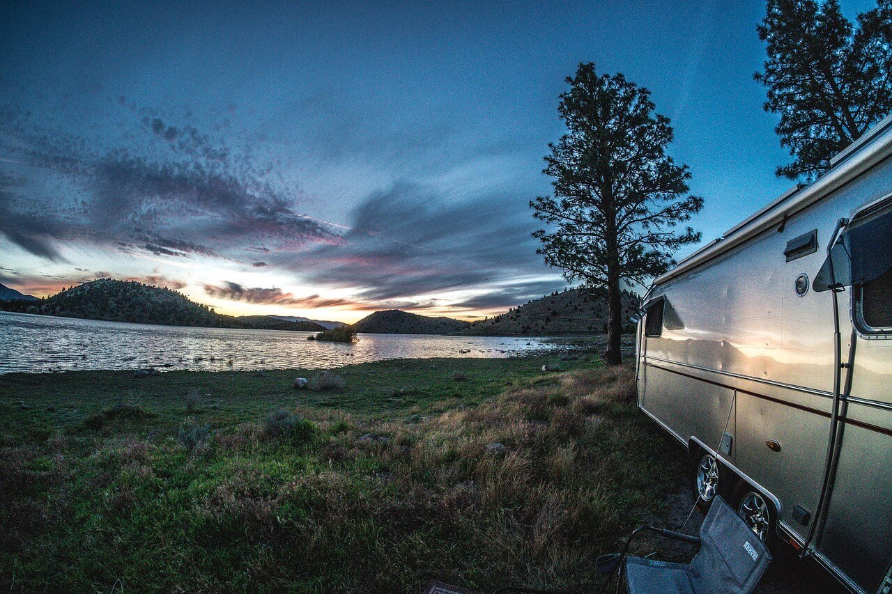 RV camping overnight by a stunning lake