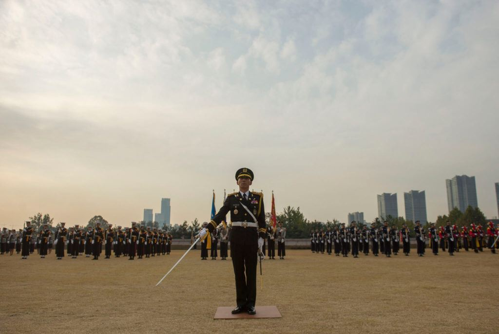 A mililtary demonstration in front of Seoul's skyline