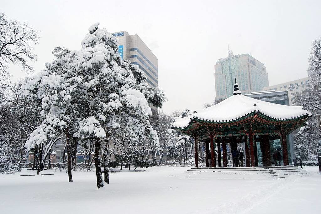 A snowed in park in Seoul in winter