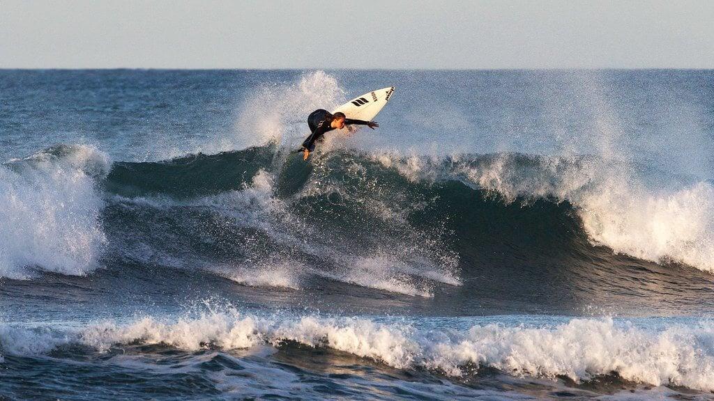 Badass chick surfing in Wellington