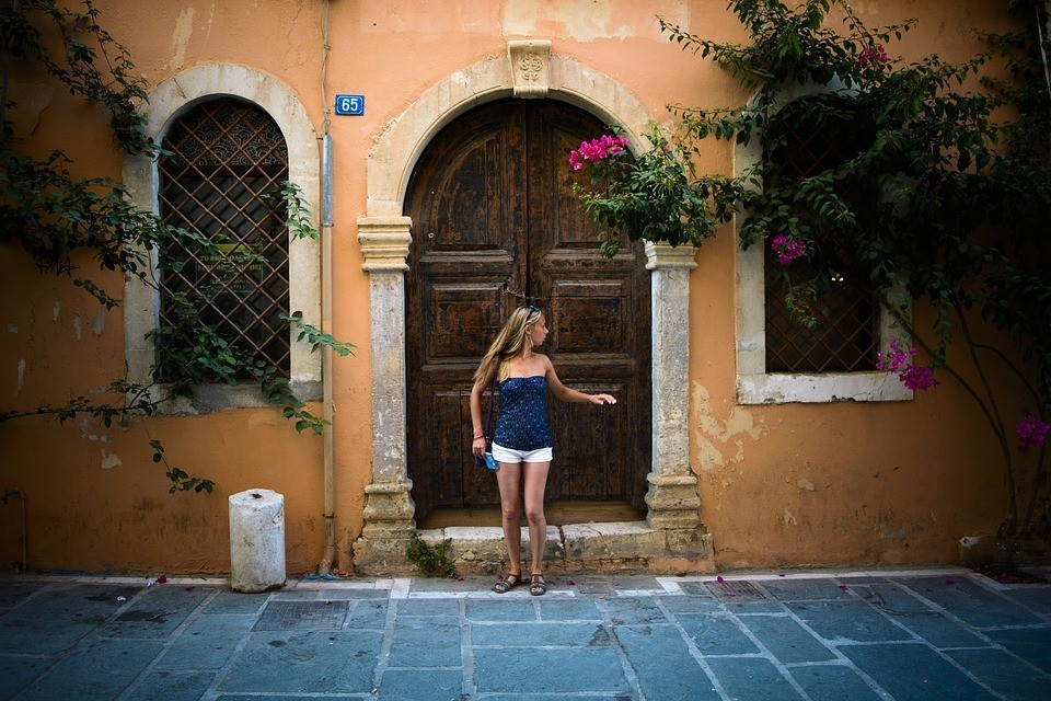 A solo female traveller staying safe in Greece in the Old Town of Crete