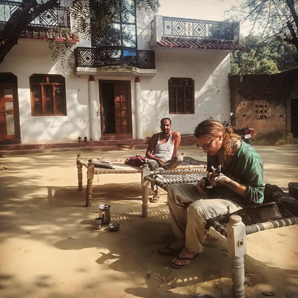 Playing a ukulele while traveling in India