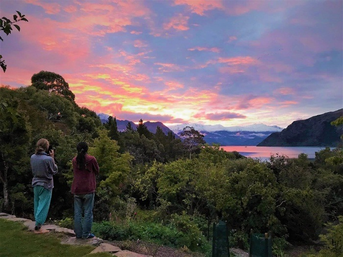 Two backpacking dirtbags enjoying a sunset in New Zealand