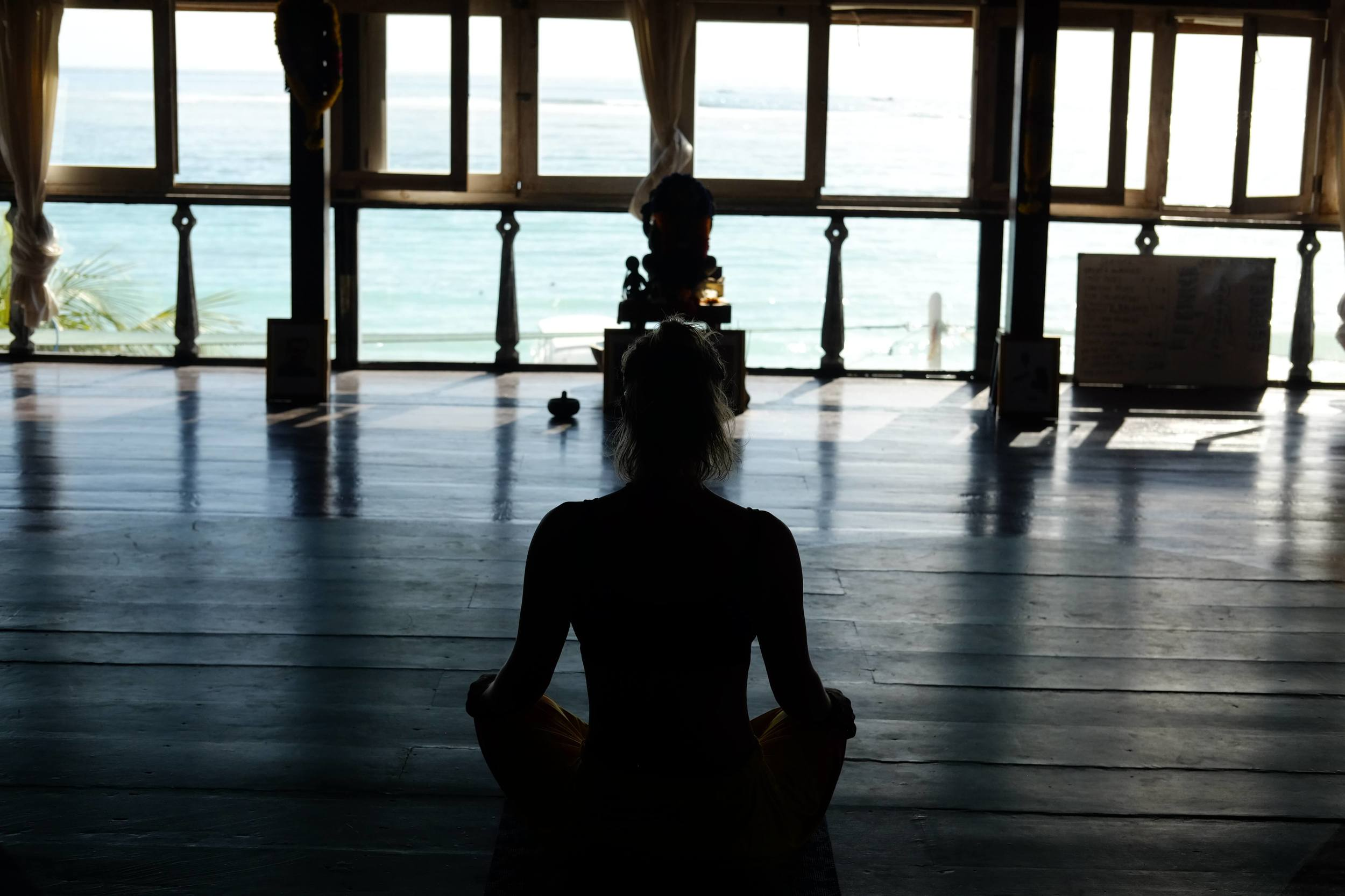 meditating at yoga retreat in bali