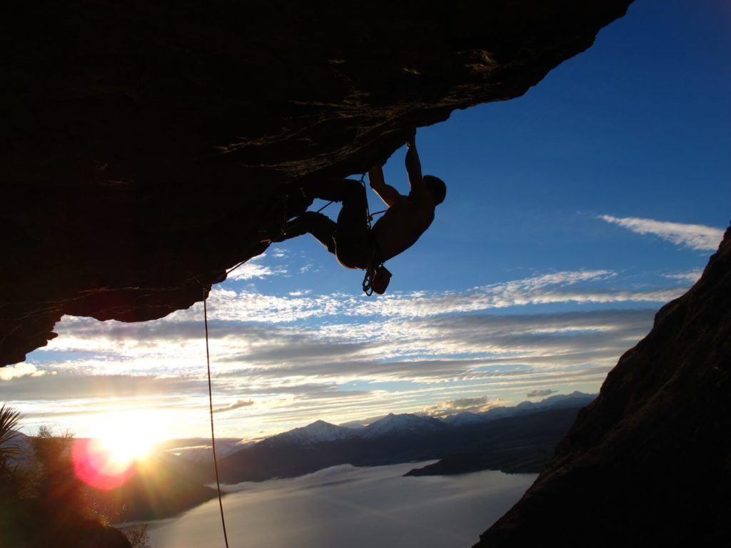 A traveller rock climbing in the Remarkables near Queenstown