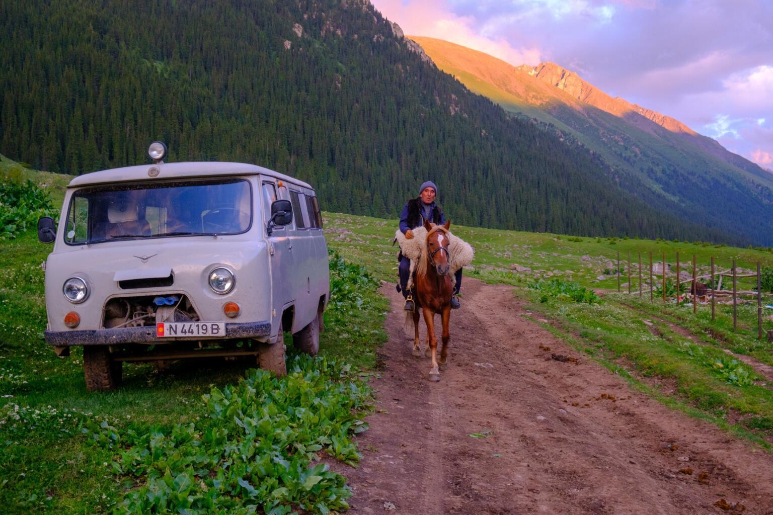 horse rider in altyn arashan sunset