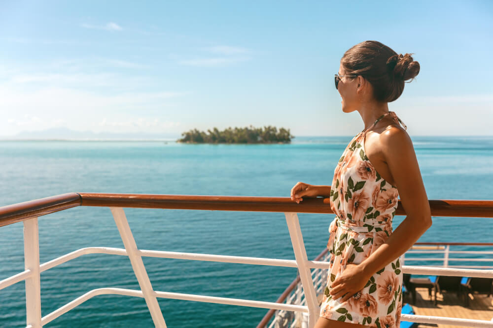 Woman enjoying a cruise amongst the long list of countries with open borders in the Caribbeans