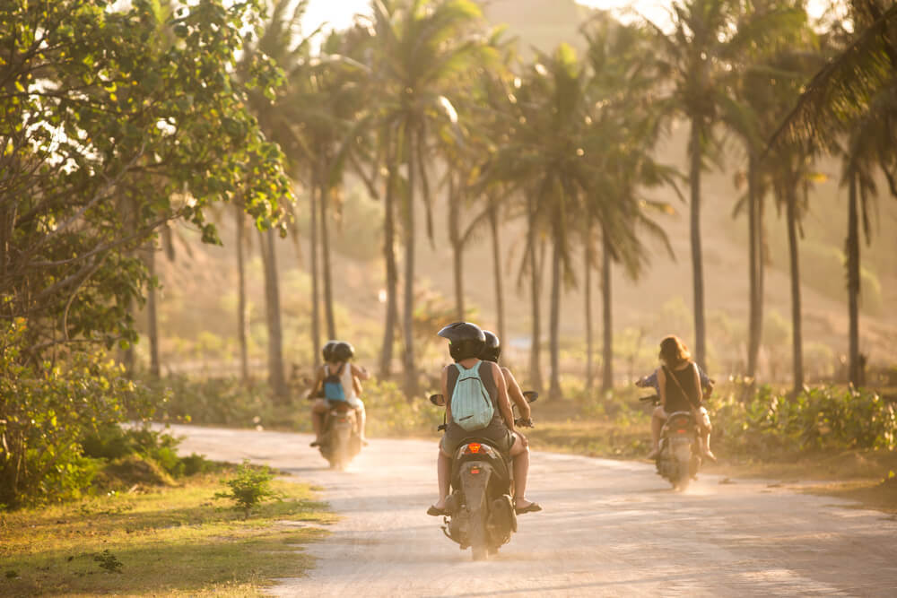people traveling around bali on scooter