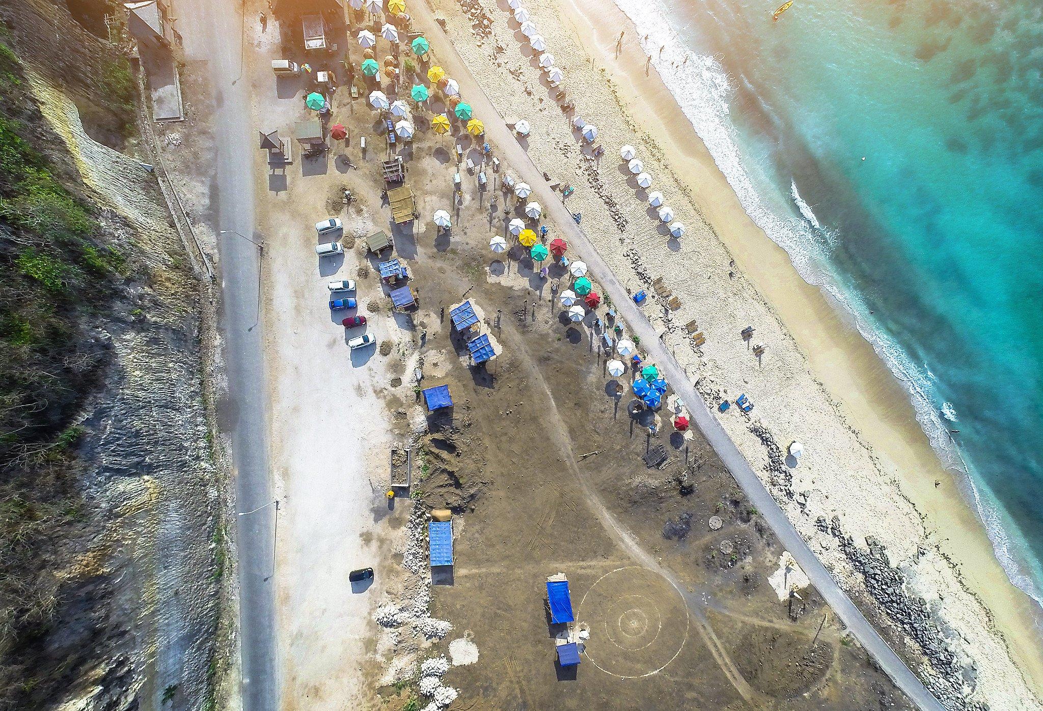 drone shot of melasti beach uluwatu