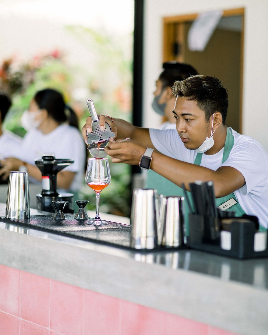 bartender pouring a cocktail at tribal hostel