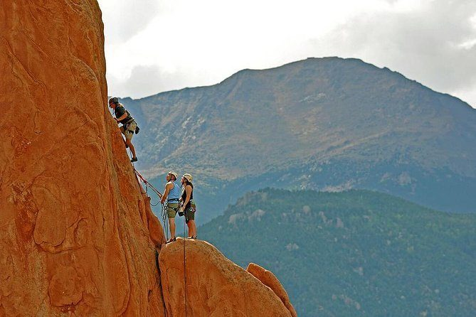 Rock Climbers with their cool gifts on a wall