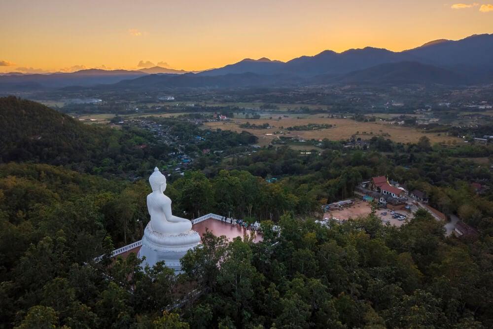 sunset at the white buddha pai thailand