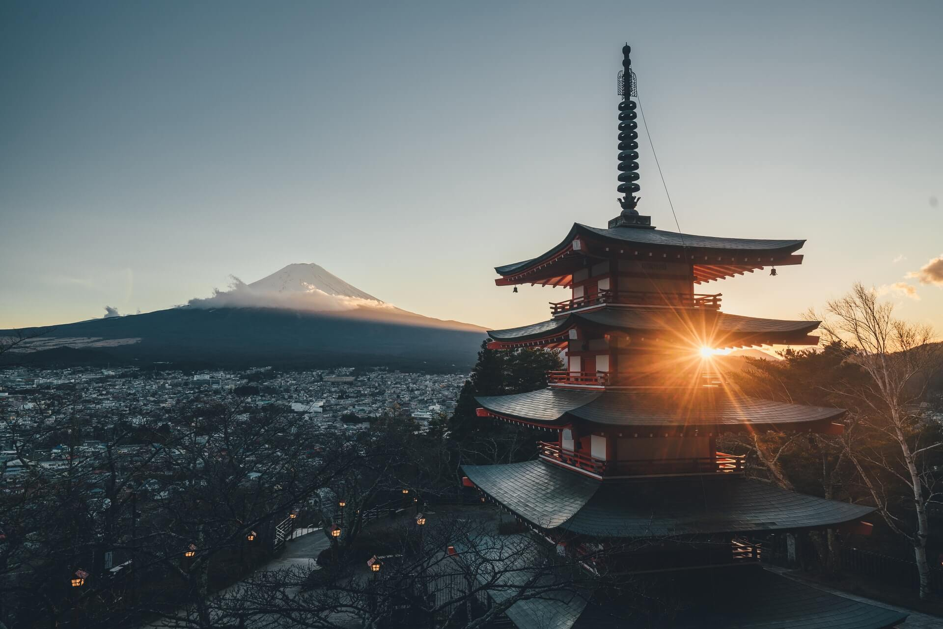 A temple and Mt Fuji in the background photographed by someone travelling in a van in Japan