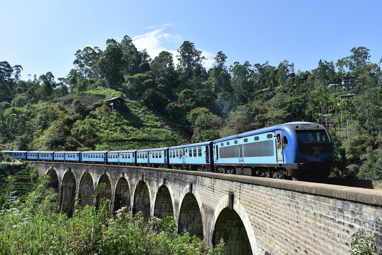 Blue express Kandy to Ella train on Nine Arch Bridge
