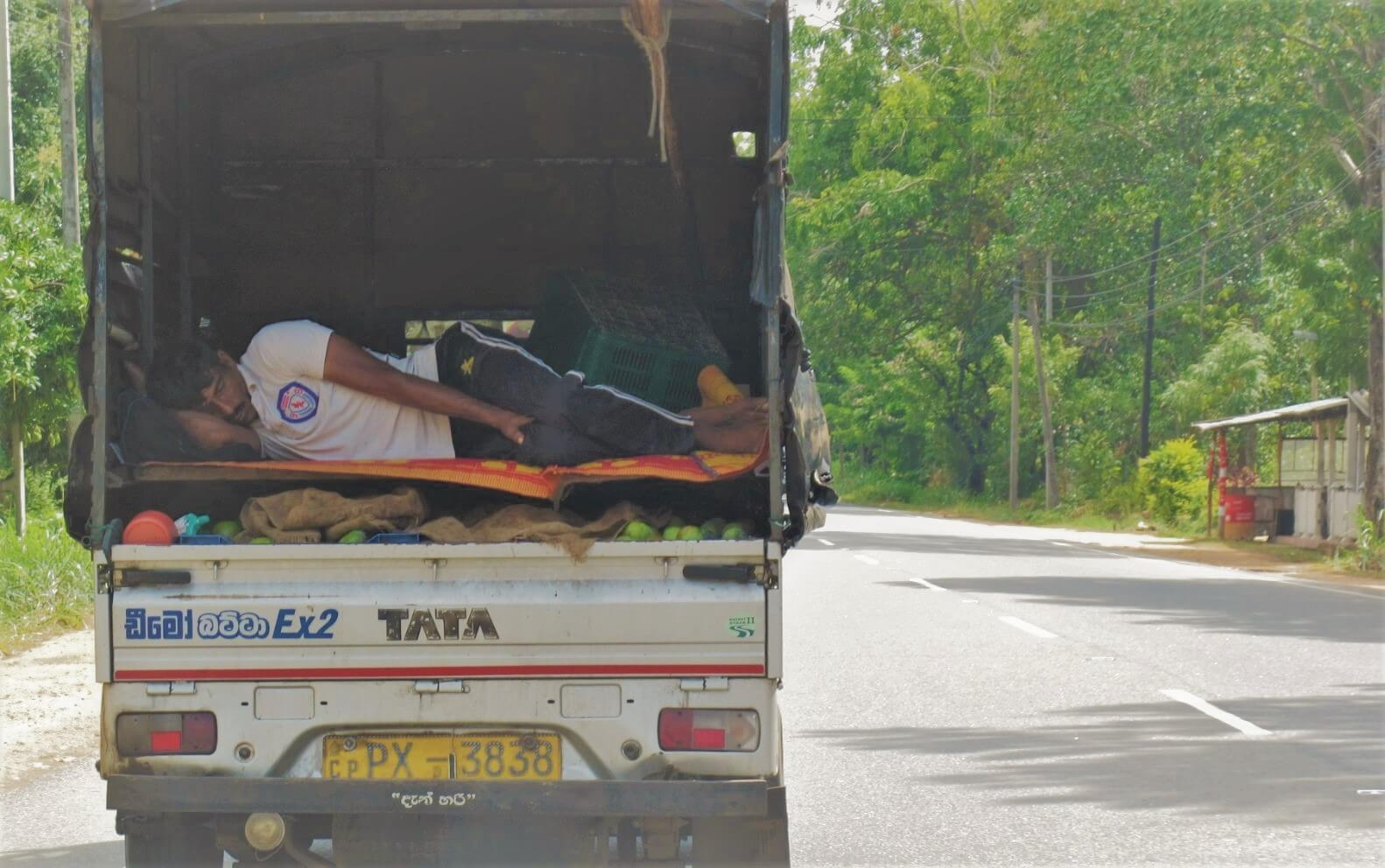 A man skips out on Sri Lanka's accommodation costs sleeping in a truck