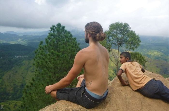 A fellow backpacker in Sri Lanka meditating at a viewpoint in Ella
