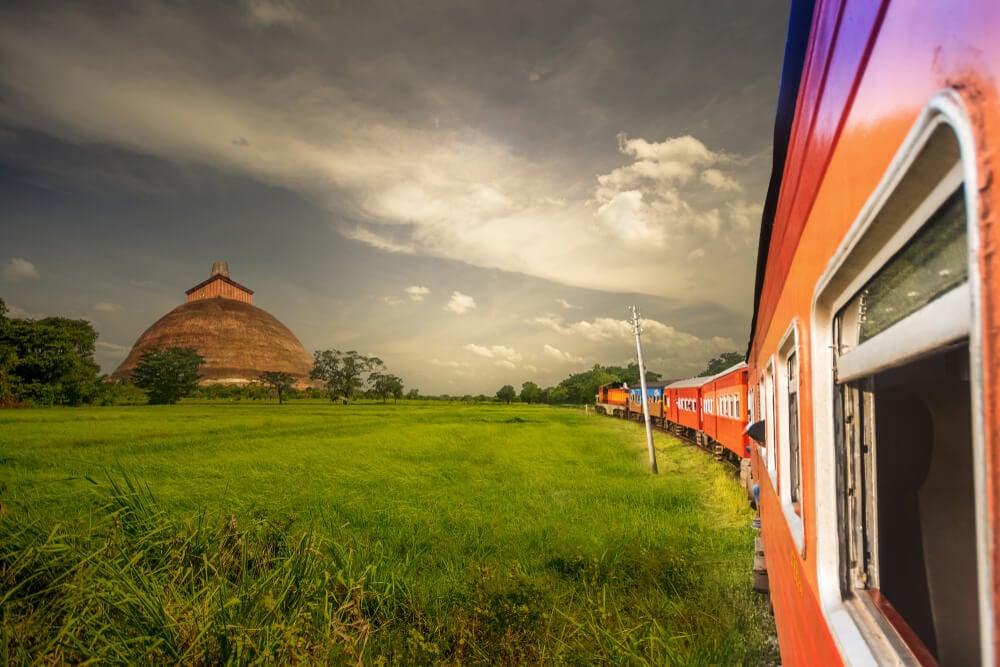 A train in Sri Lanka passing a popular cultural tourist attraction