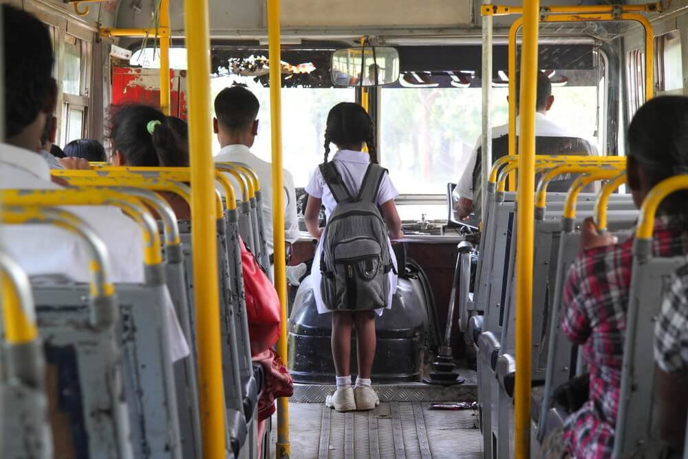 School girl on a bus in India