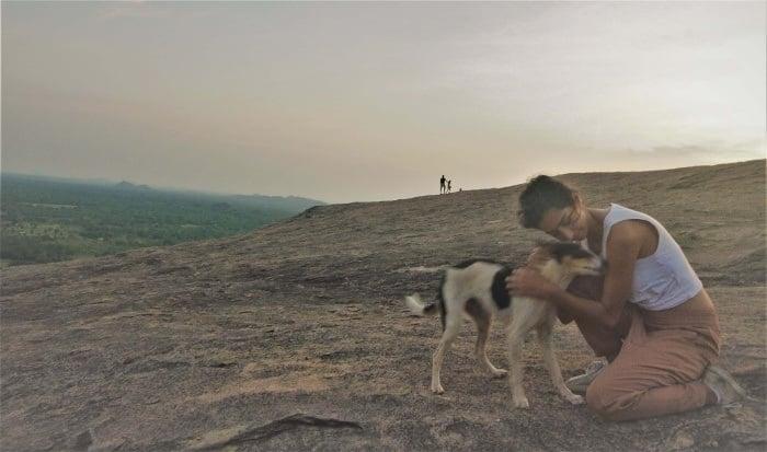 Patting a dog while backpacking Jordan
