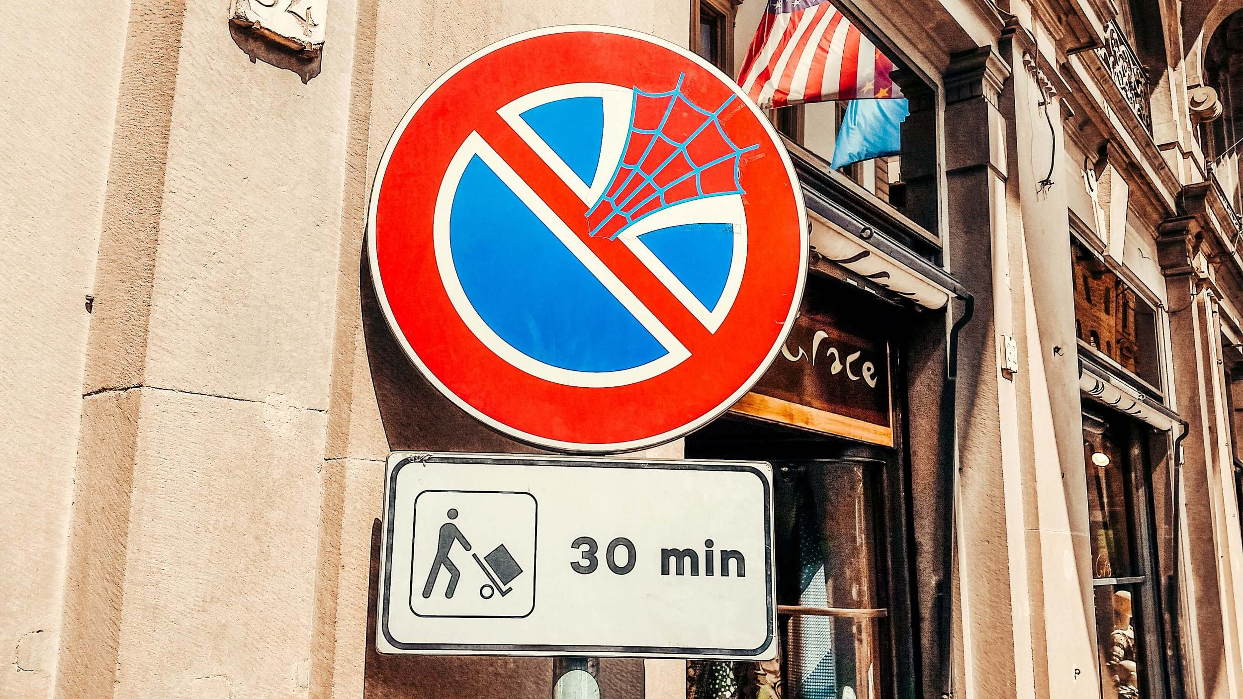 spiderman italy street sign