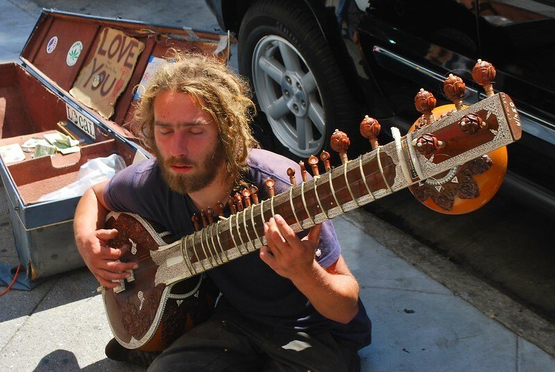Hippy busker who gets heaps of travel sex
