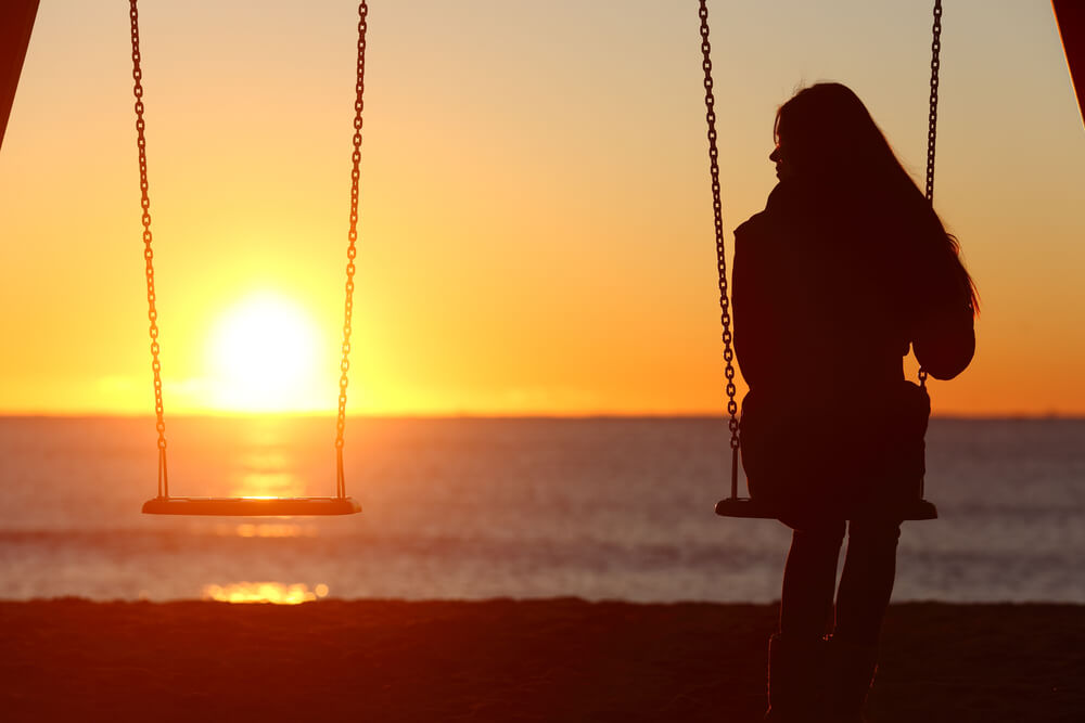 A traveller watching the sunset after having sex and being ghosted