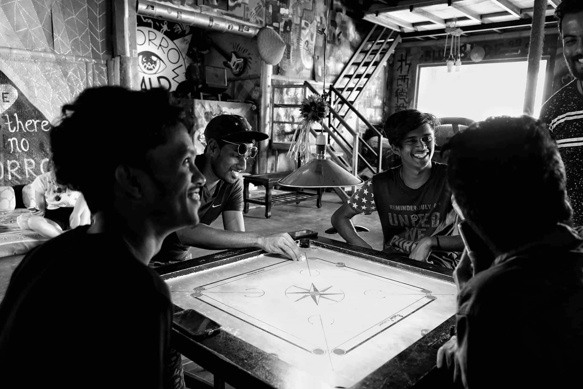 The boys playing Carom at Sri Lanka's best hostel