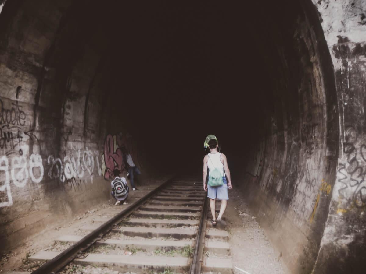 A tourist visiting attractions in Sri Lanka - the Nine Arch Bridge tunnel