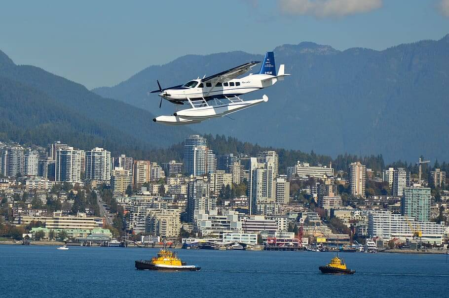 A seaplane in Vancouver landing in the harbor